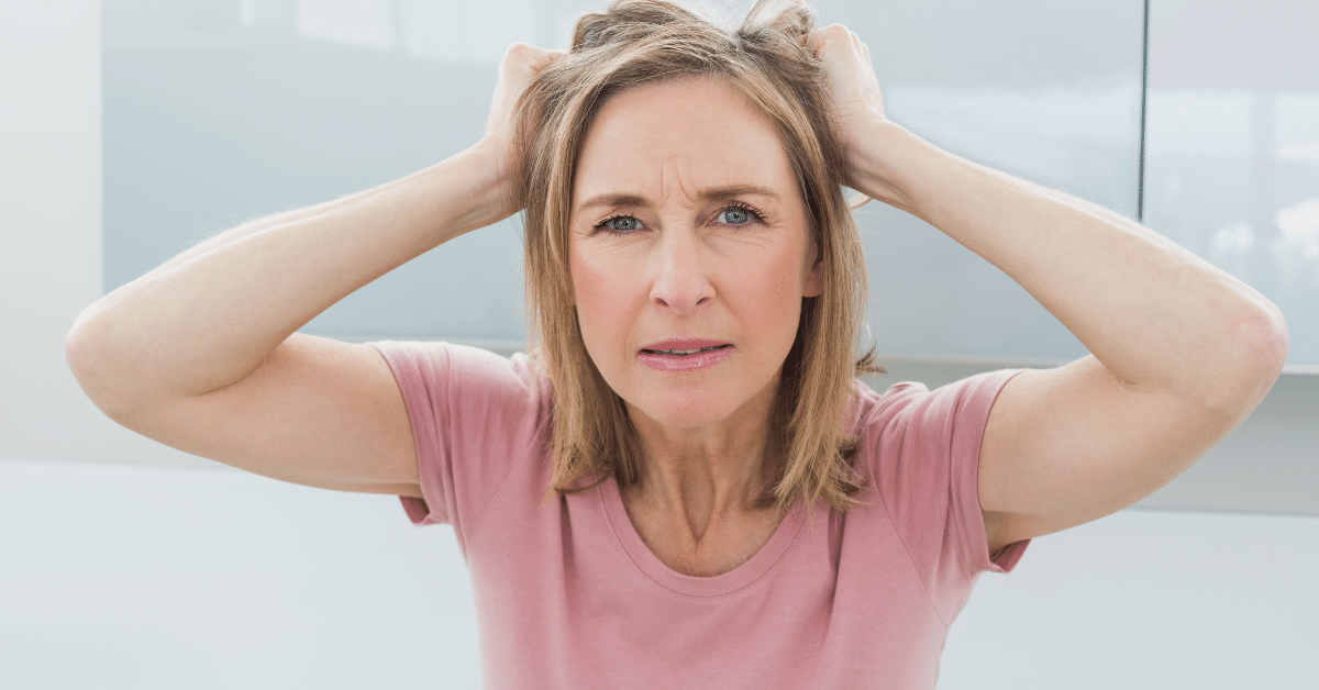 woman pulling hair for article mental effects of bad dieting advice